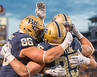 Pitt running back George Aston celebrates his 4-yard touchdown catch with tight end JP Holtz (86) and others. The Pitt Panthers football team defeated the Louisville Cardinals 45-34 on Saturday, November 21, 2015 at Heinz Field, Pittsburgh, Pennsylvania.