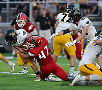 NWA Democrat-Gazette/ANDY SHUPE<br /> Prairie Grove running back Cade Grant is tackled Friday, Sept. 6, 2019, by Farmington linebacker Josh Stettmeier (47) during the first half of play at Cardinal Stadium in Farmington. Visit nwadg.com/photos to see more photographs from the game.