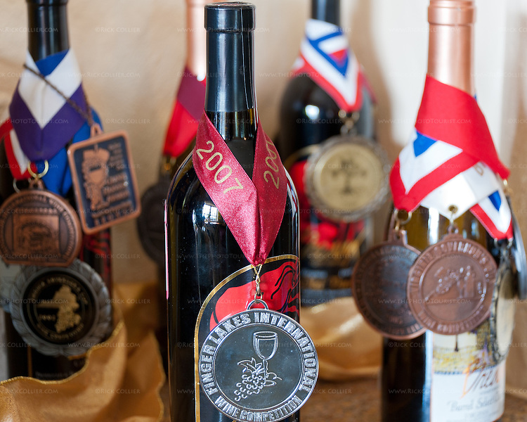A selection of medal-winning vintages, displayed proudly in a nice in the tasting room at Breaux Vineyards.