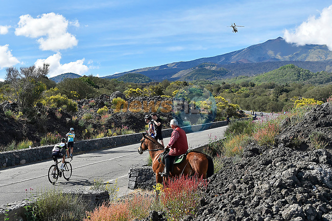 Jacques Janse Van Rensburg (RSA) Team Dimension Data passes a lone horseman during Stage 4 of the 100th edition of the Giro d'Italia 2017, running 181km from Cefalu to Mount Etna, Sicily, Italy. 9th May 2017.<br /> Picture: LaPresse/Fabio Ferrari | Cyclefile<br /> <br /> <br /> All photos usage must carry mandatory copyright credit (&copy; Cyclefile | LaPresse/Fabio Ferrari)