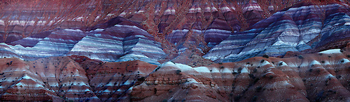 Multi-colored horizontal lines make up the landscape of the Paria Clay Beds at the Grand Staircase Escalante National Monument, Utah