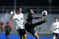 CARY, NC - DECEMBER 13: Calvin Harris #22 of Wake Forest University catches the ball in front of Bret Halsey #13 of University of Virginia during a game between Wake Forest and Virginia at Sahlen's Stadium at WakeMed Soccer Park on December 13, 2019 in Cary, North Carolina.