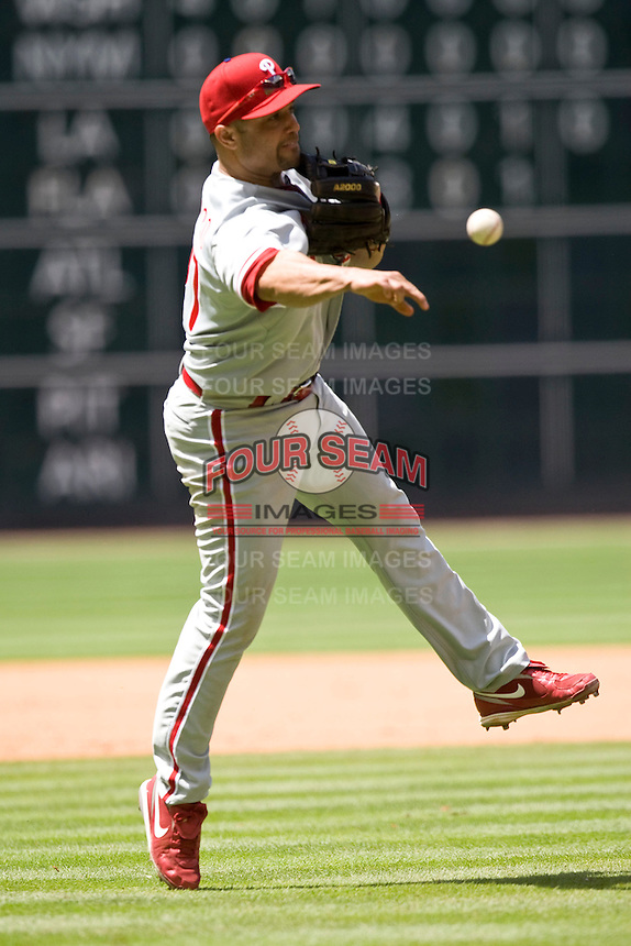 Philadelphia Phillies 3B Placido Polanco makes a play against the Houston Astros on Sunday April 11th, 2010 at Minute Maid Park in Houston, Texas.  (Photo by Andrew Woolley / Four Seam Images)