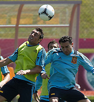 EURO 2012 - POLAND - Gniewino - 13 JUNE 2012 - Spain National Team official MD-1 training. Spanish players Santi Cazorla and Xavi Hernandez with the ball.