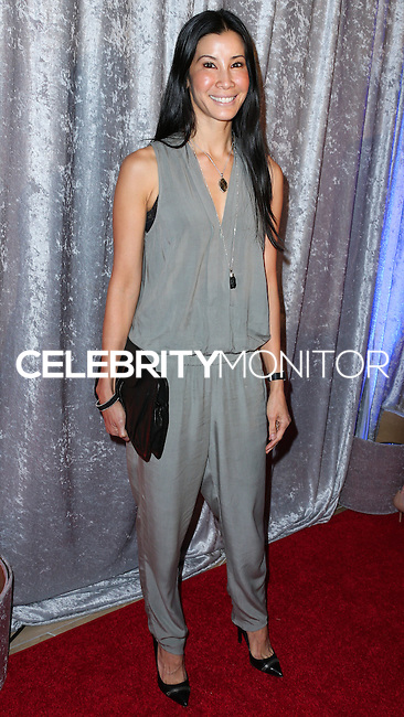 BEVERLY HILLS, CA, USA - OCTOBER 28: Lisa Ling arrives at the 25th Annual Courage in Journalism Awards held at the Beverly Hilton Hotel on October 28, 2014 in Beverly Hills, California, United States. (Photo by Xavier Collin/Celebrity Monitor)