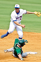 June 03, 2011:    Florida Gators inf Josh Adams (2) throws over the slide of Manhattan Jaspers catcher Ramon Ortega (31) during NCAA Gainesville Regional action between Manhattan Jaspers  and Florida Gators played at Alfred A. McKethan Stadium on the campus of Florida University in Gainesville, Florida.  Florida defeated Manhattan 17-3.........