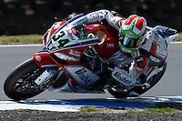 Davide Giugliano (ITA) riding the Aprilia RSV4 1000 Factory (34) of the Althea Racing team rounds turn 11 during a practise session on day two of round one of the 2013 FIM World Superbike Championship at Phillip Island, Australia.