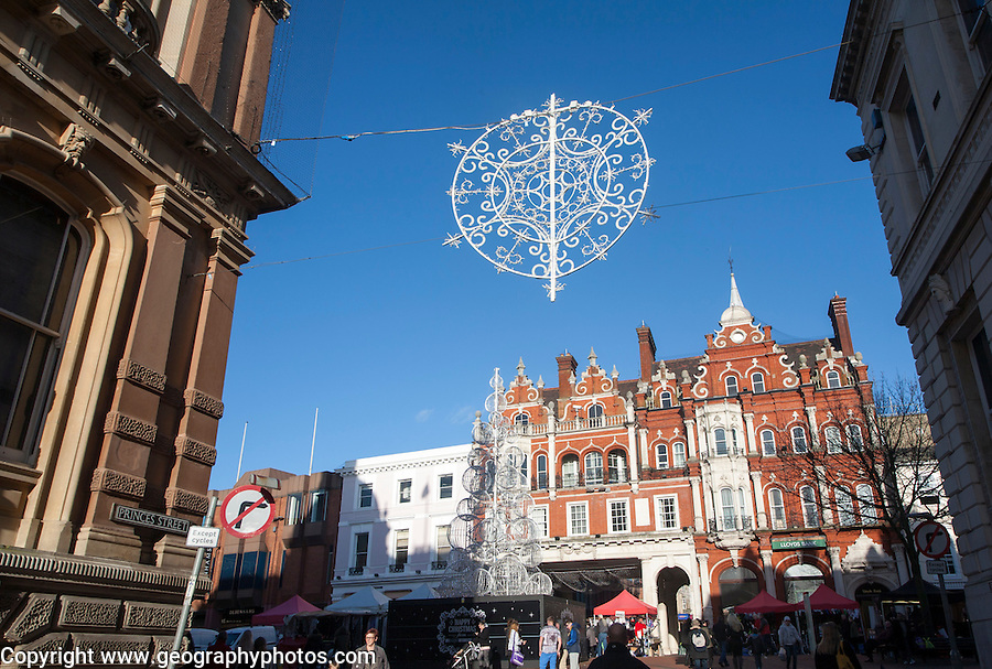 Silver Christmas decorations in the town centre of Ipswich, Suffolk, England