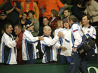 12-2-06, Netherlands, tennis, Amsterdam, Daviscup.Netherlands Russia, Russian Captain Shamil Tarpischev is bein congretulated bij the Russian team after the fift match resulted in a 0-5 score