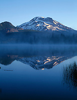 ORCAC_050 - USA, Oregon, Deschutes National Forest, Sunrise light on South Sister reflects in the misty waters of Sparks Lake.