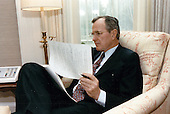 United States President George H.W. Bush reviews his first State of the Union Address in his study in the Oval Office of the White House in Washington, DC on February 8, 1989.  <br /> Mandatory Credit: David Valdez / White House via CNP