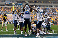 North Carolina players celebrate a safety against West Virginia during the Meineke Car Care Bowl college football game at Bank of America Stadium in Charlotte, NC.