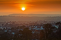 The sun sets over hills near Swansea in south Wales, UK. Friday 15 February 2019