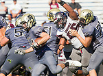 Palos Verdes, CA 09-07-18 - Mason O'Connor (Peninsula #24), Daniel Meyerhoff (Peninsula #77) and Jalen Iereneo (Torrance #65) in action during the Torrance - Palos Verdes Peninsula Varsity football game.