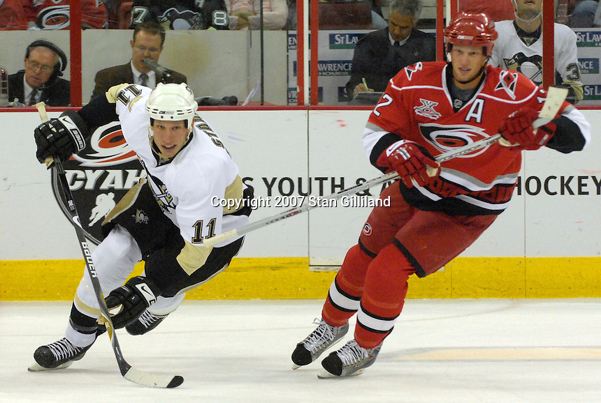 Carolina Hurricanes' Eric Staal battles his brother, the Pittsburgh Penguins' Jordan Staal during their game Friday, Oct. 5, 2007 in Raleigh, N.C. The Hurricanes won 4-1.