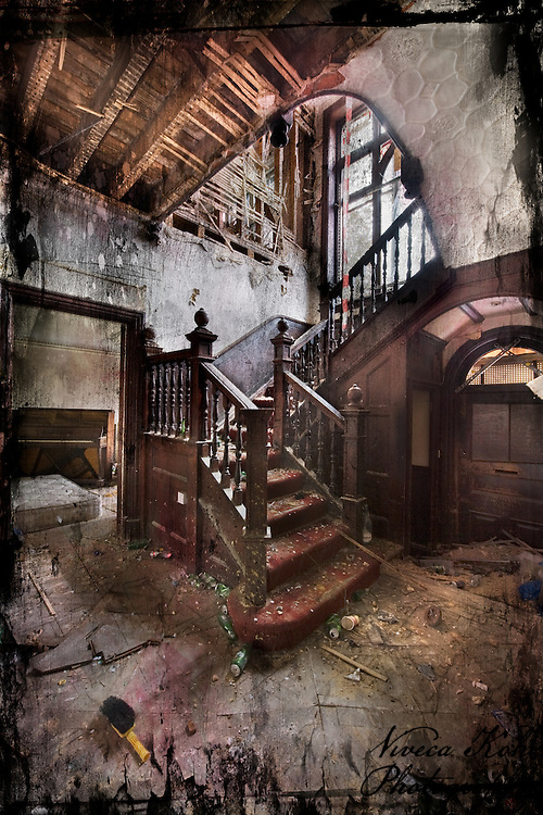 Entrance hall and stairs in an abandoned house