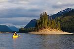 Canoeing in the evening on Upper Campbell Lake at Strathcona Park Lodge, located near Strathcona Provincial Park on Vancouver Island, British Columbia