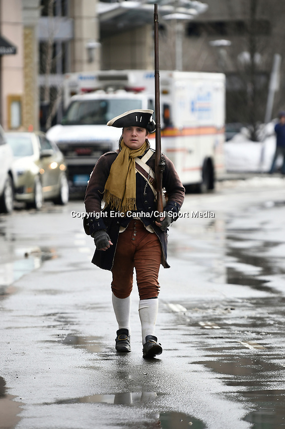February 4, 2015 - Boston, Massachusetts, U.S. -  A lone minuteman walks to the staging area before a parade held in Boston to celebrate the New England Patriots victory over the Seattle Seahawks in Super Bowl XLIX. Eric Canha/CSM
