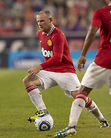 Manchester United FC forward Wayne Rooney (10) give and go pass. In a Herbalife World Football Challenge 2011 friendly match, Manchester United FC defeated the New England Revolution, 4-1, at Gillette Stadium on July 13, 2011.