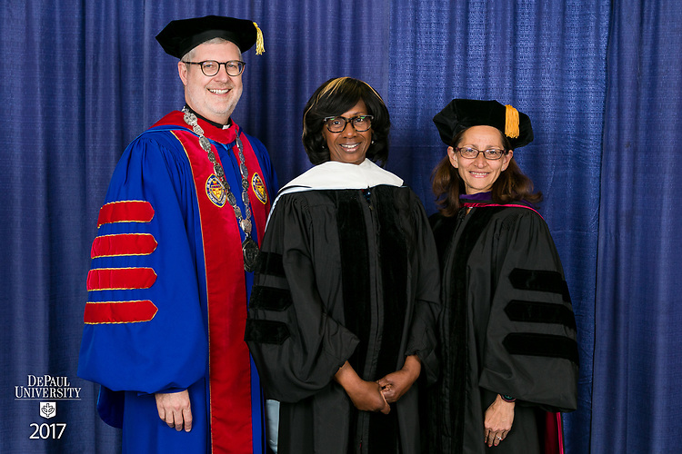 Left to right, the Rev. Dennis H. Holtschneider, C.M., president, Paulette Brown, honorary degree recipient and commencement speaker, and Jennifer Rosato Perea, dean of the College of Law. DePaul University College of Law held its commencement ceremony, Sunday, May 14, 2017, at the Rosemont Theatre in Rosemont, IL, where some 240 students received their Juris Doctors or Master of Laws degrees. (DePaul University/Jeff Carrion)