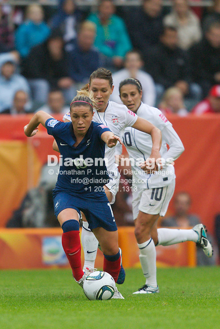 MOENCHENGLADBACH, GERMANY - JULY 13:  Camille Abily of France drives the ball against the United States during a FIFA Women's World Cup semifinal soccer match at Stadion im Borussia Park on July 13, 2011  in Moenchengladbach, Germany.  Editorial use only.  Commercial use prohibited.  No push to mobile device usage.  (Photograph by Jonathan P. Larsen)