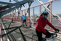 """NEW YORK, NY - APRIL 19: People wearing face masks cross the Williamsburg Bridgeon April 19, 2020 in New York City. NY Governor Andrew Cuomo announced this week that the """"New York Pause State"""" order will continue until May 15. In addition, he announced that everyone should wear face masks and continue to use social distance in public places as infections continue to rise with nearly 130,000 infections and 8,800 deaths from COVID-19. (Photo by Pablo Monsalve/VIEWpress via Getty Images)"""