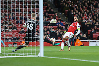 A shot by Theo Walcott of Arsenal (right) is saved by Goalkeeper Denis SCHERBITSKI of FC BATE Borisov during the UEFA Europa League match between Arsenal and FC BATE Borisov  at the Emirates Stadium, London, England on 7 December 2017. Photo by David Horn.