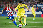 Angel Correa of Atletico de Madrid competes for the ball with Alvaro Gonzalez of Villarreal during the match of La Liga between Atletico de Madrid and Villarreal at Vicente Calderon  Stadium  in Madrid, Spain. April 25, 2017. (ALTERPHOTOS/Rodrigo Jimenez)