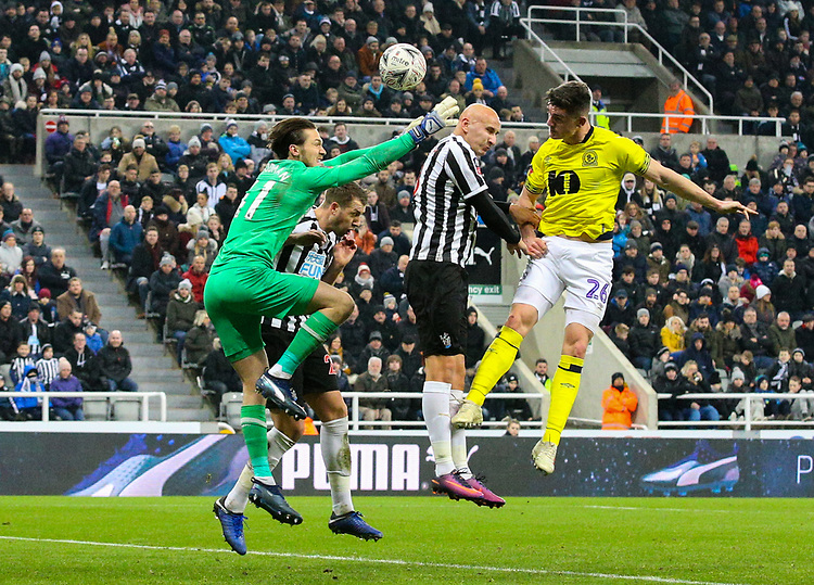 Blackburn Rovers' Darragh Lenihan heads goalward under pressure from Newcastle United's Jonjo Shelvey and Freddie Woodman<br /> <br /> Photographer Alex Dodd/CameraSport<br /> <br /> Emirates FA Cup Third Round - Newcastle United v Blackburn Rovers - Saturday 5th January 2019 - St James' Park - Newcastle<br />  <br /> World Copyright © 2019 CameraSport. All rights reserved. 43 Linden Ave. Countesthorpe. Leicester. England. LE8 5PG - Tel: +44 (0) 116 277 4147 - admin@camerasport.com - www.camerasport.com