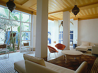 The spacious living room is furnished with contemporary sofas and opens onto the riad's central courtyard