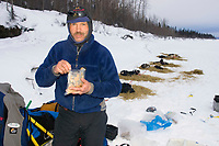 Robert Sorlie on Yukon River Eating a Snack Eagle Is Chkpt 2005 Iditarod