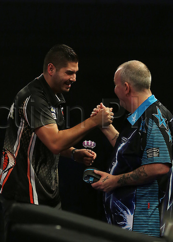30.12.2015. Alexandra Palace, London, England. William Hill PDC World Darts Championship. Jelle Klaasen wins the match and shakes hands with Phil Taylor