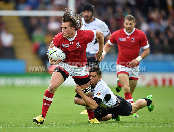 Jeff Hassler of Canada is tackled by Catalin Fercu of Romania. Rugby World Cup Pool D match between Canada and Romania on October 6, 2015 at Leicester City Stadium in Leicester, England. Photo by: Patrick Khachfe / Onside Images