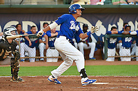 Ivan Vela (3) of the Ogden Raptors at bat against the Missoula Osprey in Pioneer League action at Lindquist Field on August 4, 2014 in Ogden, Utah.  (Stephen Smith/Four Seam Images)