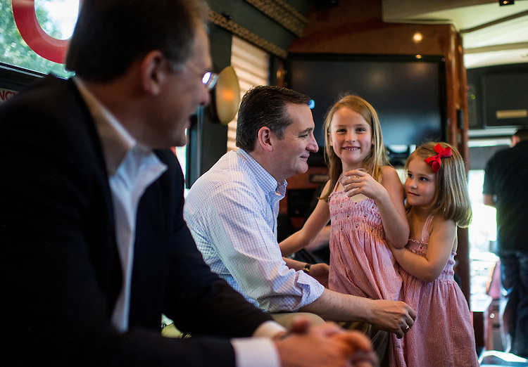 UNITED STATES - AUGUST 8: Presidential candidate Sen. Ted Cruz (R-TX) spends a few moments with his daughters Caroline, center, and Catherine, right, before the start of the Cruz bus tour rally in a field behind Sprayberry's BBQ in Newnan, Ga., on Saturday, Aug. 8, 2015. (Photo By Bill Clark/CQ Roll Call)