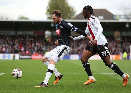 April 14th 2017,  Brent, London, England; Skybet Championship football, Brentford versus Derby County; Richard Keogh of Derby County blocks Romaine Sawyers of Brentford from the ball