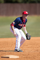 Tyler Betz (4) of the Shippensburg Raiders takes infield practice prior to the game against the Belmont Abbey Crusaders at Abbey Yard on February 8, 2015 in Belmont, North Carolina.  The Raiders defeated the Crusaders 14-0.  (Brian Westerholt/Four Seam Images)
