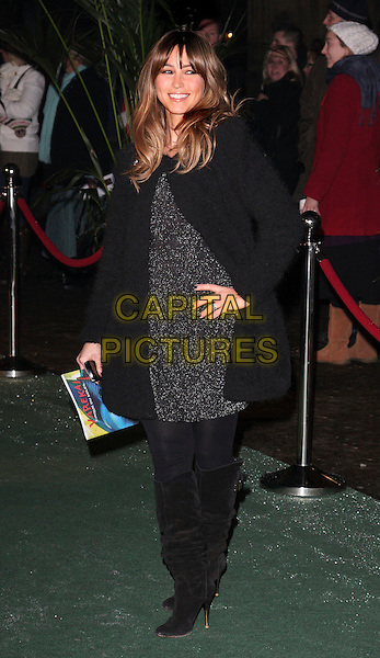 RACHEL STEVENS .Attending the Gala VIP Opening Night of Cirque du Soleil's 'Varekai' at the Royal Albert Hall, London, England, UK, .January 5th 2010..arrivals full length black coat suede knee high slouchy boots tights dress hand on hip  .CAP/ROS.©Steve Ross/Capital Pictures.