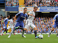 Pictured: Joe Allen of Swansea (R) marked by John Terry of Chelsea (L). Saturday 17 September 2011<br />