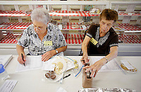 NWA Democrat-Gazette/DAVID GOTTSCHALK  Entries and judges inside the Thompson Hall Adult Home Economics building on the Washington County Fair Grounds in Fayetteville Monday, August 31 2015. The hall was being cleaned and display areas prepared in preparation for the Washington County Fair that runs September 1-5.