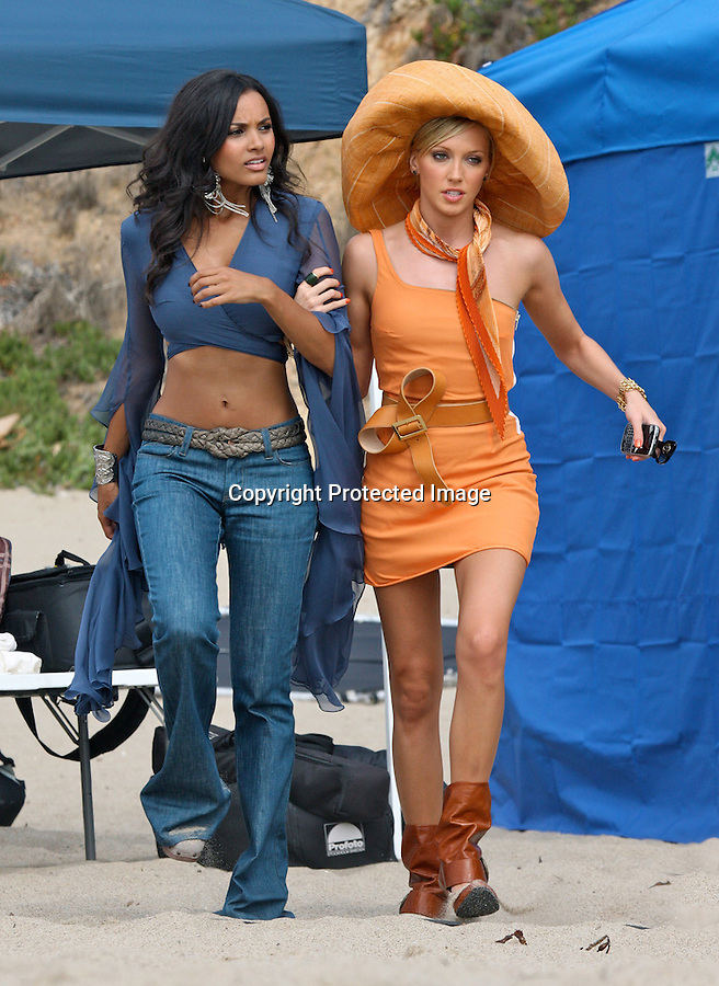 9-28-09  Monday ..Malibu California Katie Cassidy & Jessica Lucas filming a scene for the new TV show Melrose Place in Malibu California. Katie was wearing an orange dress with a huge hat & a looped belt. Katie ate a banana during break & drank some juice.  Katie ate some salad for lunch & text messaged on her phone. Katie was constantly being sprayed down with sunscreen to protect her from hot sun. Daphne Zuniga from the old Melrose place was also on set ....AbilityFilms@yahoo.com.805-427-3519.www.AbilityFilms.com