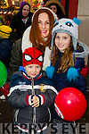 Pictured at the Tralee Christmas Parade on Saturday were l-r: Ethan and Sienna Trainer with Michaela Layden, Ballyduff.