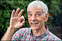 BNPS.co.uk (01202 558833)<br /> Pic: PhilYeomans/BNPS<br /> <br /> Lucky wedding ring found in a giant haystack...<br /> <br /> Married John Tressider got the needle when he lost his wedding ring in a giant haystack - only to find it two weeks later using a metal detector.<br /> <br /> John, 68, from East Budleigh, Devon, had been helping out on his auntie's farm and was moving 200 large bales of straw when he noticed his gold Celtic band had come off his finger.<br /> <br /> After two separate 'needle in a haystack' searches for it he borrowed a friend's metal detector and finally found it close to the bottom of the 20ft tall stack.