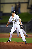 UCF Knights relief pitcher Campbell Scholl (30) delivers a pitch during a game against the Siena Saints on February 17, 2017 at UCF Baseball Complex in Orlando, Florida.  UCF defeated Siena 17-6.  (Mike Janes/Four Seam Images)