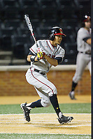 LaMonte Wade (6) of the Maryland Terrapins follows through on his swing against the Wake Forest Demon Deacons at Wake Forest Baseball Park on April 4, 2014 in Winston-Salem, North Carolina.  The Demon Deacons defeated the Terrapins 6-4.  (Brian Westerholt/Four Seam Images)