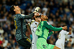 Thibaut Courtois (L) and Sergio Ramos (R) of Real Madrid and Youssef En-Nesyri of CD Leganes during La Liga match between Real Madrid and CD Leganes at Santiago Bernabeu Stadium in Madrid, Spain. October 30, 2019. (ALTERPHOTOS/A. Perez Meca)