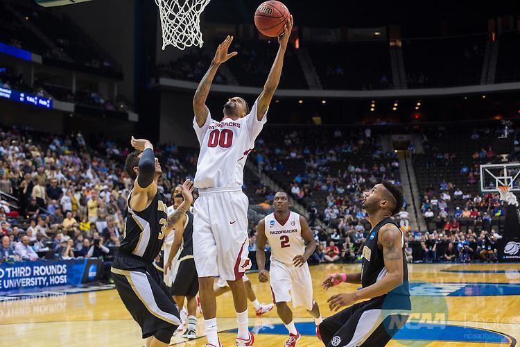 19 MAR 2015:  Rashad Madden (00) of University of Arkansas scores during the 2015 NCAA Men's Basketball Tournament held at Veterans Memorial Arena in Jacksonville, FL.  Matt Marriott/NCAA Photos