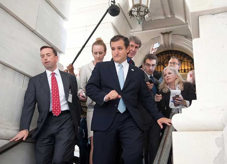 UNITED STATES - Sept 25: Sen. Ted Cruz (R-TX) leaves the Senate Chamber after his 21 plus hour speech that started on September 24, and ended on September 25, 2013. Sen. Cruz is leading the effort in the Senate to defund Obamacare.  (Photo By Douglas Graham/CQ Roll Call)
