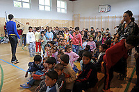 """Young children enter the gymnasium for a performance by Roma or gypsy theater Romathan in """"Dwarf"""" at the Banske Elementary School with a Roma or gypsy majority student body in Banske, Slovakia on June 2, 2010."""