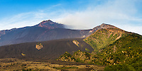 Panoramic photo of Mount Etna Volcano, with a lava field in the foreground, Sicily, UNESCO World Heritage Site, Italy, Europe. This is a panoramic photo of Mount Etna Volcano with a lava field in the foreground, Sicily, UNESCO World Heritage Site, Italy, Europe.